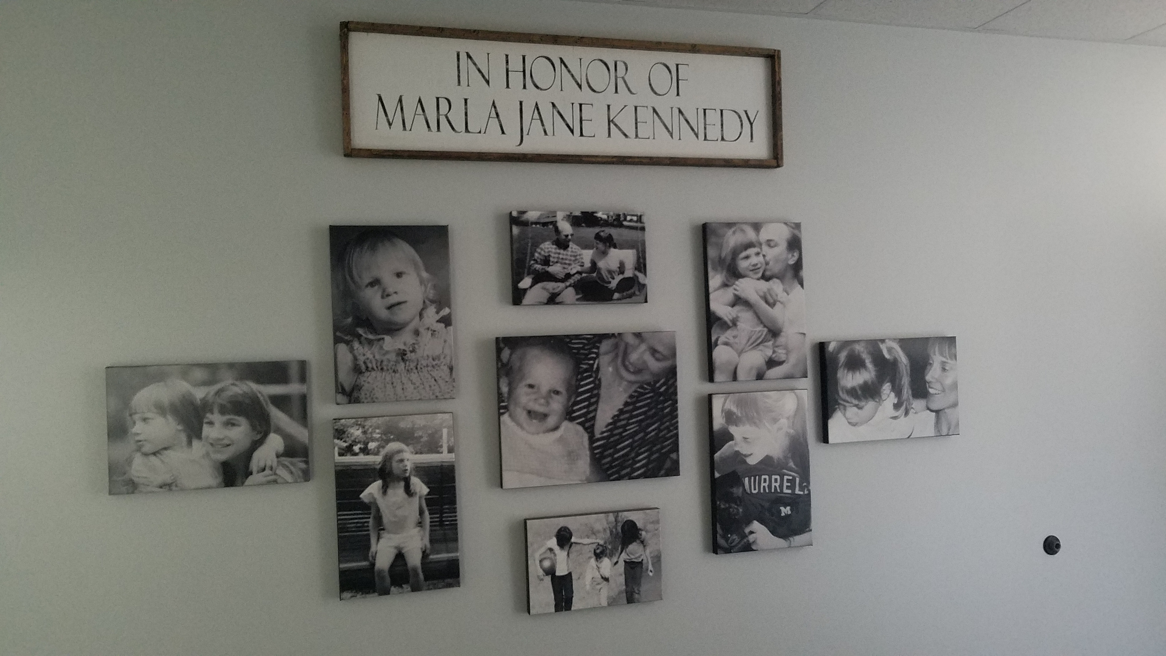 Pictures on wall of Marla Kennedy
